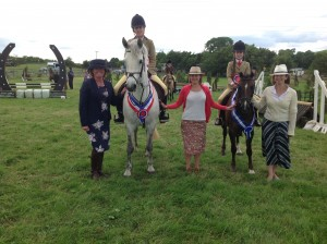 4th July 2015 Working Hunter CHampionship.  Alexandra Ryan and Tuckmill Star and Reserve Champion  Ellie McDonnell and Belle Vue Royal Jester with Judges Amanda Lilley, Ashley Stephens and Maria Gormley
